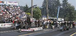 Mark Niver, left, a longtime driver in the NHRA, leaves the starting line in his Top Alcohol dragster during a semifinal run against Shawn Cowie at the NHRA Northwest Nationals. Niver died Sunday after he crashed during the semifinal.