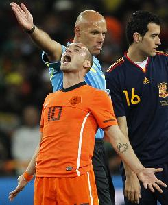 Wesley Sneijder, front, is among the Netherlands players critical of the performance of English referee Howard Webb, middle, at the World Cup final on Sunday.