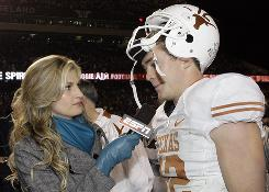 ESPN's Erin Andrews talks to Texas quarterback Colt McCoy after a game last season.