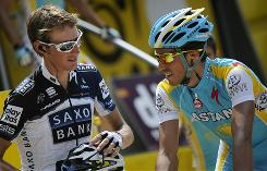 Andy Schleck, left, says defending Tour de France champion Alberto Contador, right, looked to be in 'difficulty' during the eighth stage on Sunday.