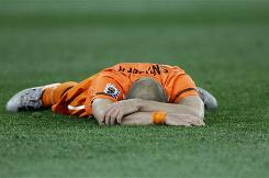 Netherlands midfielder Wesley Sneijder lies on the pitch after losing to Spain in the World Cup final. The Dutch also lost in the final in 1974 and 1978.