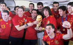 Spain's team poses with the trophy aboard its return plane flight from South Africa after winning the World Cup for the first time.