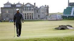 Tiger Woods prepares to line up a putt on the 17th hole at the Old Course at St Andrews. Though Woods has not played up to his standards this year, he is still the bettors' favorite for the British Open.