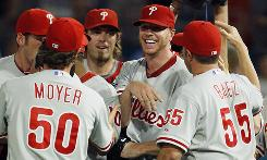 Roy Halladay (second from right) is one of two pitchers to celebrate perfect games this season. Halladay and the Oakland A's Dallas Braden notched the rare feats in May. Their accomplishments are one reason many are calling this the year of the pitcher.