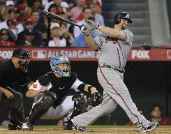 Brian McCann of the Atlanta Braves hits a three run double in the seventh inning to give the NL a 3-1 lead.