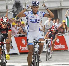 France's Sandy Casar celebrates his victory in the ninth stage of the Tour de France at the finish line in Saint-Jean-de-Maurienne.