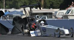 Courtney Force's dragster comes to rest after losing a tire and portions of her rear wing at Pacific Raceways.