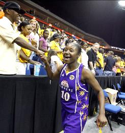 Los Angeles Sparks guard Andrea Riley, a former Oklahoma State player, gives a fist bump to a fan after the Sparks' 87-71 win over the Tulsa Shock.