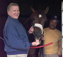 Owner George Steinbrenner poses with Kentucky Derby entry Concerto inside the barns at Churchill Downs in Louisville, Ky. Concerto finished ninth in the 1997 Derby.