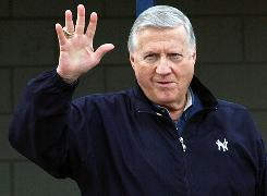 New York Yankees owner George Steinbrenner waves to fans in February 2003.