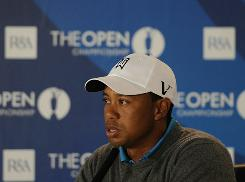 Tiger Woods answers questions from the news media, many of them about his personal life, before the start of this week's Open Championship on the Old Course at St Andrews.