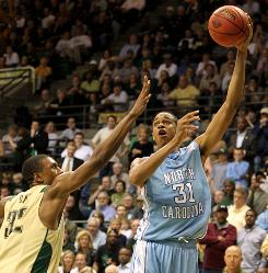 North Carolina's John Henson is trying to bulk up for his sophomore season, eating as many as six or seven meals a day to help him throw his weight around in the paint this season.
