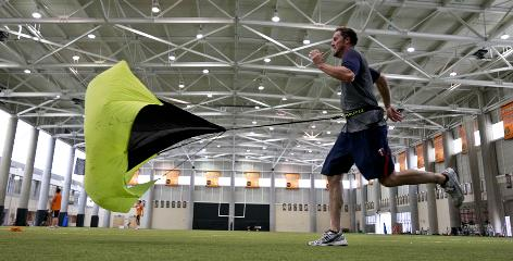 Twins closer Joe Nathan, rehabbing from Tommy John surgery he had in March, sprints backward with a parachute strapped to his waist.