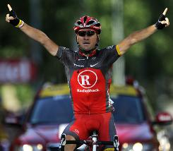 Portugal's Sergio Paulinho raises his arms in triumph after winning the 10th stage of the Tour de France. Paulinho won a two-man sprint through the Alps.