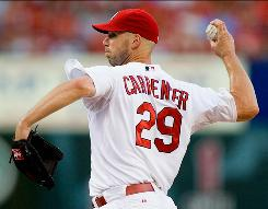 St. Louis Cardinals pitcher Chris Carpenter allowed four hits in eight innings Thursday against the Los Angeles Dodgers in St. Louis.