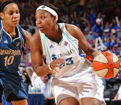 The Liberty's Cappie Pondexter drives against Mystics defender Lindsey Harding at Madison Square Garden.