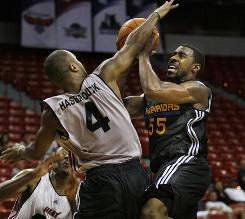 Golden State's Reggie Williams is blocked by Miami's Kenny Hasbrouck during an NBA summer league game in Las Vegas.