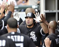 Carlos Quentin of the Chicago White Sox is congratulated by teammates in the dugout after hitting a solo home run against the Kansas City Royals on July 10 in Chicago. The Sox will need plenty of offense with the departure of starting pitcher Jake Peavy, who underwent shoulder surgery this week.