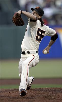 San Francisco Giants pitcher Tim Lincecum delivers against the New York Mets during the second inning in San Francisco.