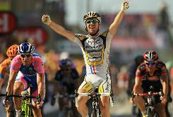 Mark Cavendish crosses the finish line to win stage 11 of the Tour de France in Bourg-les-Valence.