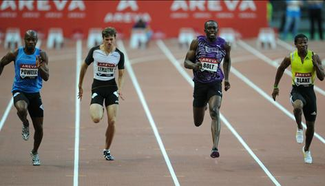 From left, Asafa Powell, Christophe Lemaitre, Usain Bolt and Yohan Blake run during the 100 meters at the Paris Diamond League meet on Friday. Bolt won the event for his 14th consecutive victory in a 100 final.