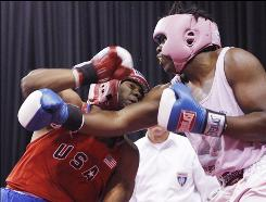 "Lenroy Thompson, right in a June 2009 bout, is seeking his second title at the USA Boxing National Championships on Saturday. The 21-year-old super-heavyweight fights his opponents decked out in light pink headgear, trunks with the cause's signature pink ribbon and a T-shirt that reads ""Fighting is a lot easier when your opponent isn't cancer."""