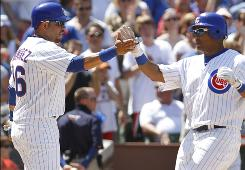 The Cubs' Aramis Ramirez, left, celebrates his two-run home run in the eighth inning against the Phillies with teammate Marlon Byrd. The blast was one of three hits for Ramirez in Chicago's 4-3 victory.