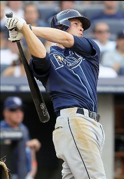 Reid Brignac follows through on three-run homer in the fifth inning, one of two the Rays second baseman hit in the 10-5 win.