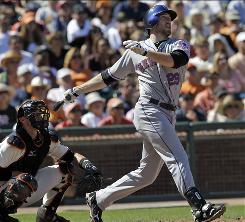 New York Mets first baseman Ike Davis drives in the go-ahead run with a double against the Giants on Sunday.