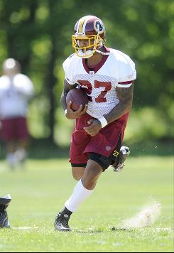Redskins running back Larry Johnson goes through drills during minicamp in May. In March, Johnson signed a three-year deal with Washington after spending last season with the Cincinnati Bengals.