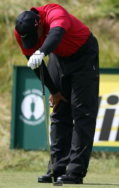 Tiger Woods shows his frustration after an errant tee shot on the sixth hole during the final round of the British Open on the Old Course at St. Andrews.