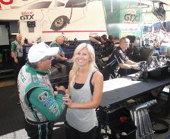 Courtney Force and her father, John, share a lighter moment in their team's garage area at Infineon Raceway.