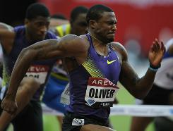 David Oliver runs to victory in the 110-meter hurdles at the Paris Diamond League meet on Friday. Oliver's time of 12.89 is an American record in the event.