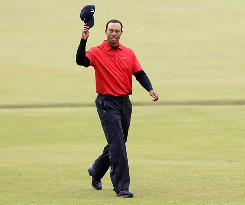 Is Tiger Woods waving good-bye to TV ratings for golf now that his game has slipped? In reality, he's walking the 18th fairway during the final round of the British Open on Sunday in St. Andrews, Scotland.
