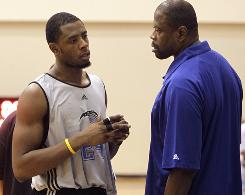 Magic summer league coach Patrick Ewing, right, talks to his son Patrick Jr. during a timeout in an NBA summer league game on July 7.