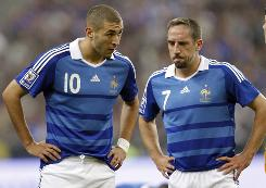 Karim Benzema, left, and Franck Ribery were detained by French police for questioning as part of a Paris-based special prostitution brigade's investigation into an alleged sex ring.