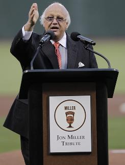 """Only in America,"" Jon Miller told fans at a ceremony before a July 16 Giants game celebrating his election to the Baseball Hall of Fame. He also threw out the game's ceremonial first pitch."