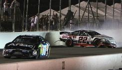 Carl Edwards, left, and Brad Keselowski were put on probation by NASCAR for the latest dust-up in their long-simmering feud.