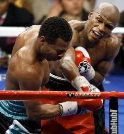 Floyd Mayweather Jr., hitting Shane Mosley in May, said he was in no hurry to fight Manny Pacquiao, who may face off with Antonio Margarito.