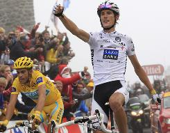 Andy Schleck, right, of Luxembourg crosses the finish line with Alberto Contador of Spain, wearing the overall leader's yellow jersey, to win the 17th stage of the Tour de France.