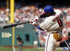 Phillies first baseman Ryan Howard clears the bases with a bases-loaded triple during Philadelphia's seven-run third inning.