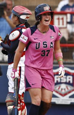Lauren Lappin celebrates after scoering in the second inning during the United States' 8-0 rout of Japan at the World Cup of Softball.