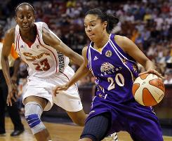Los Angeles guard Kristi Toliver, right, scored 15 points and hit four three-pointers off the bench to help the Sparks beat the Connecticut Sun.