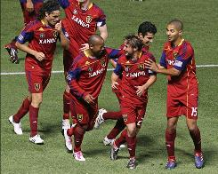 Players of Real Salt Lake celebrate a goal against Chivas USA on Saturday at Rio Tinto Stadium in Sandy, Utah. Real Salt Lake and Chivas tied 1-1.