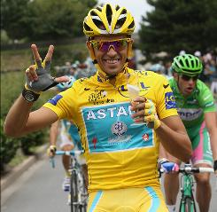 Spain's Alberto Contador celebrates his third career Tour de France triumph with a glass of champagne during the 20th and final stage. Contador won the event by 39 seconds over Luxembourg's Andy Schleck.