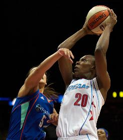 Atlanta Dream forward Sancho Lyttle (20) shoots over New York Liberty guard Leilani Mitchell (5). Lyttle had 11 points to help the Dream snap a four-game losing streak.