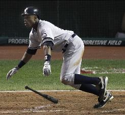 The Yankees' Curtis Granderson drops his bat as he watches his two-run homer to right field in the eighth inning against the Indians.