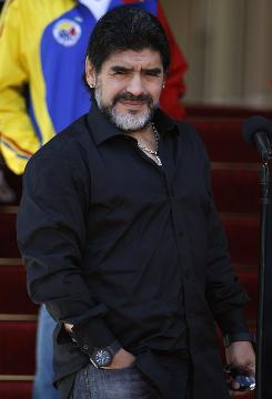 Diego Maradona, listening to a question before meeting with Venezuela president Hugo Chavez on July 22, coached Argentina to the quarterfinals of the FIFA World Cup.