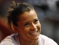Alicia Sacramone beat reigning world champion Bridget Sloan on beam in Chicago despite competing in her first meet since the 2008 Beijing Olympics.