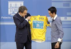 Spain's Prime Minister Jose Luis Rodriguez Zapatero, left, receives the Tour De France overall leader's yellow jersey from three-time winner Alberto Contador. Rodriguez and the entire country of Spain have had a lot to celebrate this year.